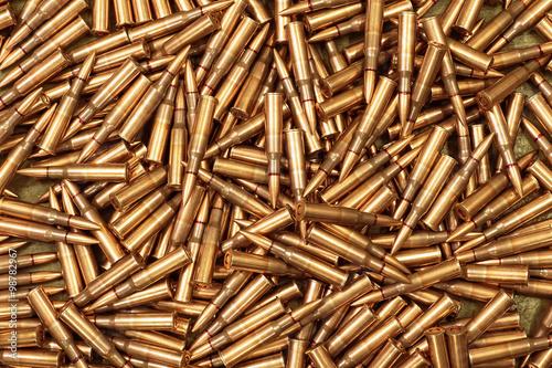 Fototapeta ammo to machine guns as background