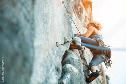 Rock climbing on vertical flat wall - Stock image