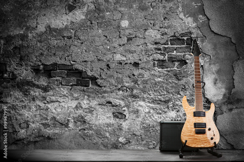 Electric guitar on a brick wall background