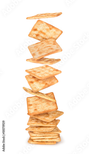 Fényképezés big stack of crackers falling from a height on an isolated white