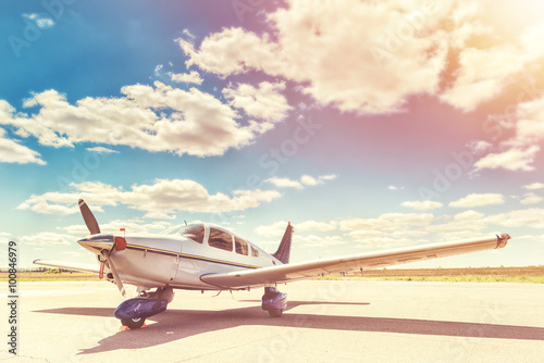 Canvas Print Propeller plane parking at the airport.