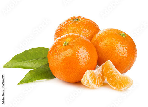 Ripe mandarines with leaves close-up on a white background. Tangerines with leaves on a white background.