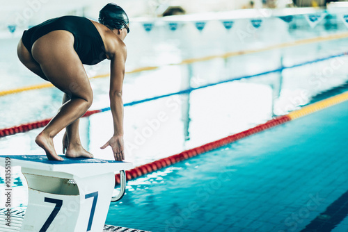 Canvas Print Freestyle swimming race start, swimmer on the starting block