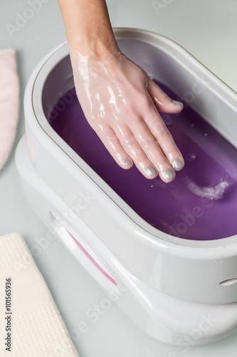 Wallpaper Mural Female hands in a paraffin wax bowl