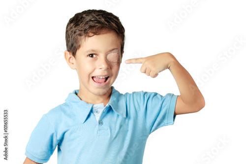 Obraz na płótnie Child with eye patch isolated on white background