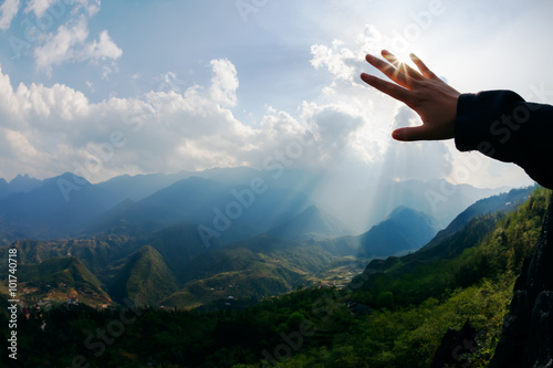 Canvas Print Touch to the sun. Hand touching the sky with ray. Freedom concep