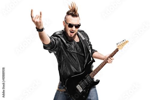 Fotografie, Obraz Punk rock guitarist making rock gesture