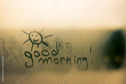 Valokuvatapetti Happy sunny face sign with good morning written on foggy window background