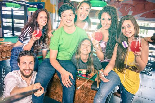 Obraz na plátně Best friends taking selfie at billiard pool table with back lighting - Happy fri
