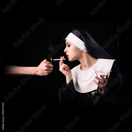 Wallpaper Mural Smoking young nun with wineglass