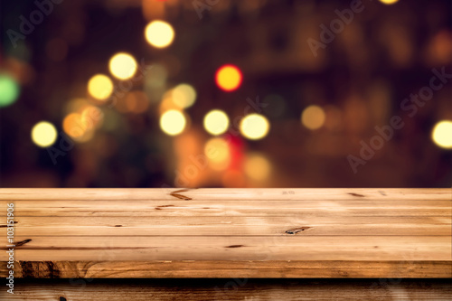 Empty wooden table for product placement or montage with focus to the table top, blurred bokeh background Fototapeta