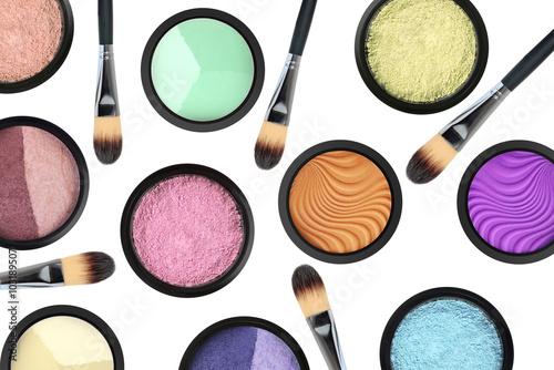 Stampa su Tela set of many eyeshadows and brushes isolated on white background
