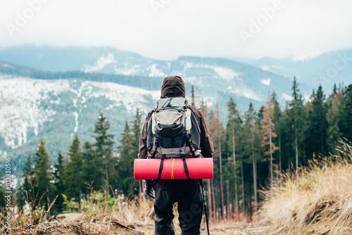 Obraz na plátně caucasian male hiking in mountains