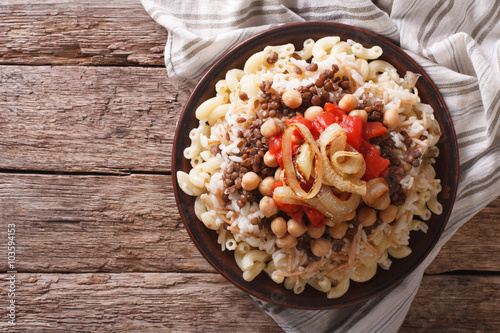 Egyptian kushari of rice, pasta, chickpeas and lentils horizontal top view