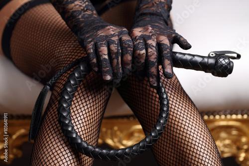 Fototapeta Woman holding whip
