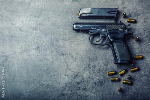 Valokuvatapetti 9mm pistol gun and bullets strewn on the table.
