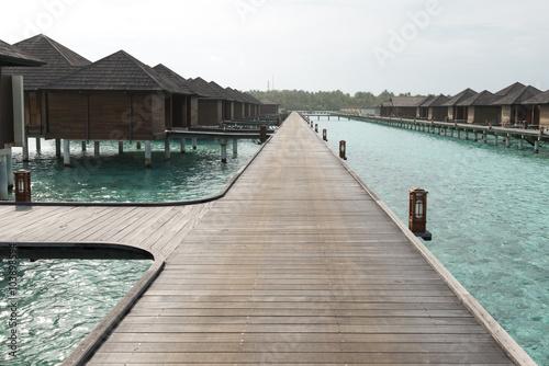 Maldives. Villa piles on water Fototapeta