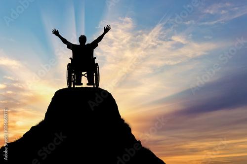 Vászonkép Silhouette happy disabled person