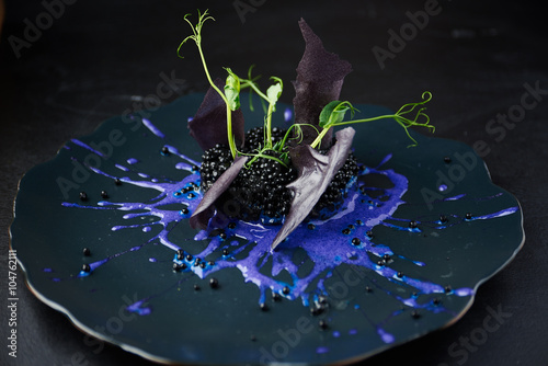 Canvas Print Risotto with cuttlefish ink and black caviar
