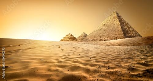 Obraz na plátně Pyramids in sand