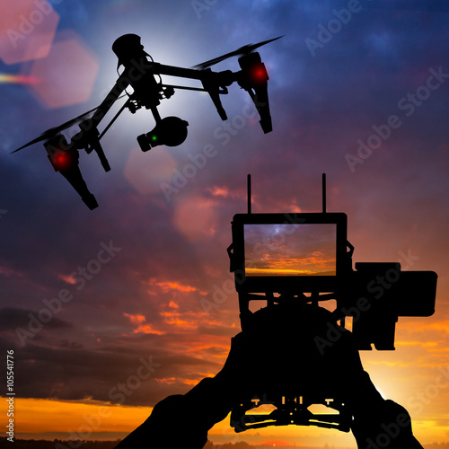 Drone with 4K camera flying.