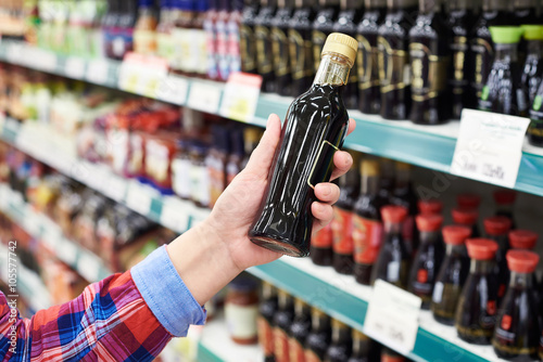 Buyer with soy sauce in store