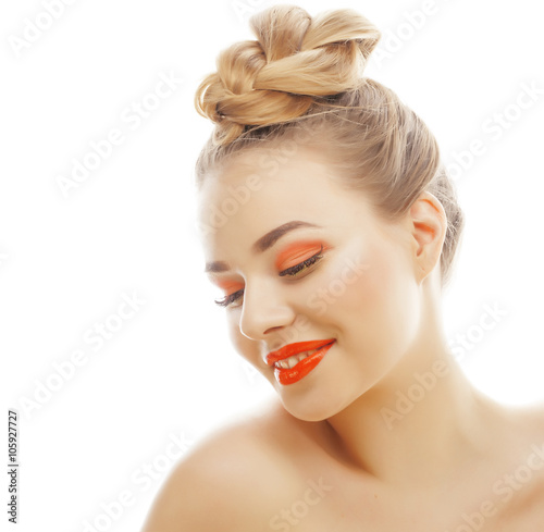 young blond woman with bright make up smiling pointing gesturing emotional isolated like doll lashes on white