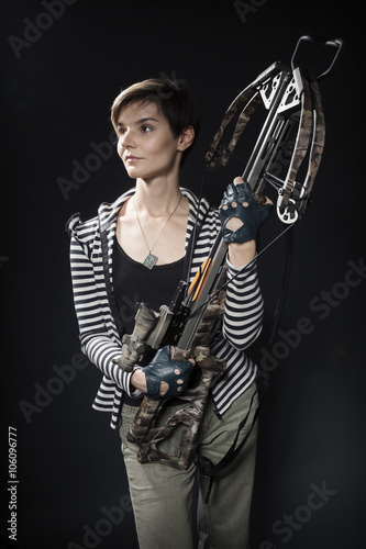 Stampa su Tela young woman with a crossbow