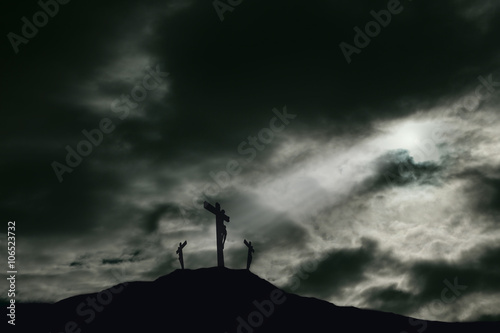 Leinwand Poster Crucifixion of Jesus on Golgotha With Darkened Sky and Copy Space
