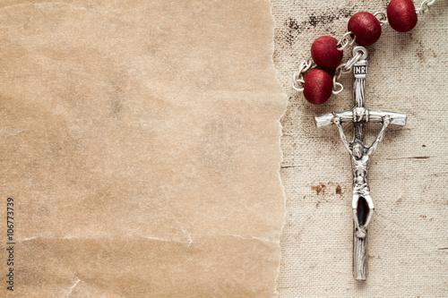Obraz na plátně Catholic rosary and paper piece