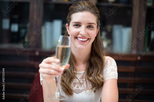 Portrait of happy woman holding champagne flute