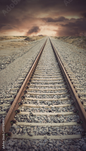 railway track with vintage look disappearing into the far distance
