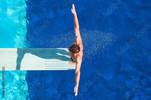Diver on the springboard, ready to jump backwards