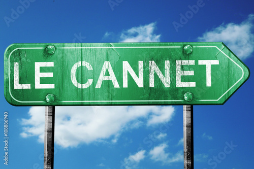 Canvas Print le cannet road sign, vintage green with clouds background