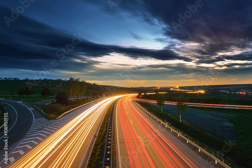 Stampa su Tela Long-exposure sunset over a highway