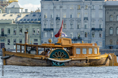 Canvas Print Vintage steam ship on the river Neva in the background of the waterfront