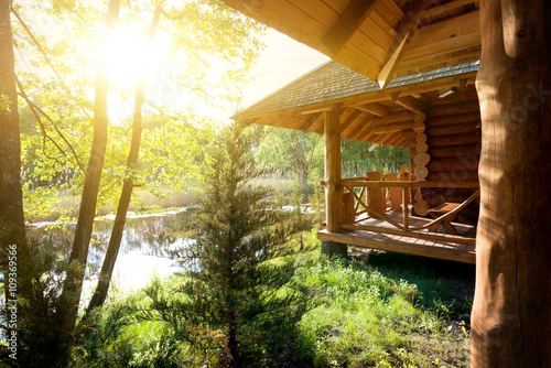 Canvas-taulu Wooden house and pond