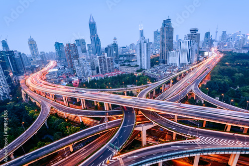Fotografia, Obraz Aerial view of a highway overpass at night in Shanghai -  China.