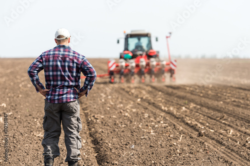 Fototapeta young farmer on farmland