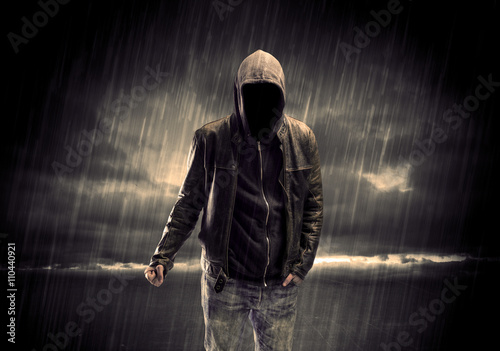 Obraz na płótnie Anonymous terrorist in hoodie at night