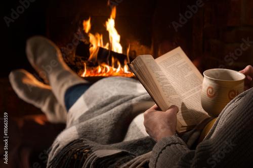 Wallpaper Mural Woman reads book near fireplace