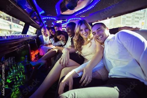 Fotografia Happy friends chatting in limousine