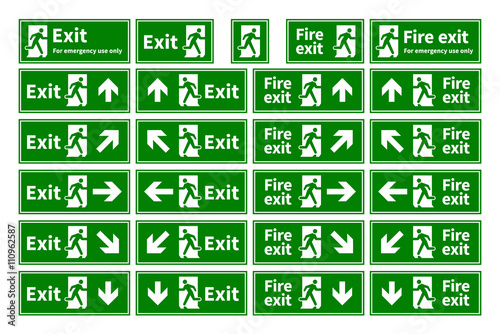 Fotografija Set of emergency fire exit green signs with different directions on white
