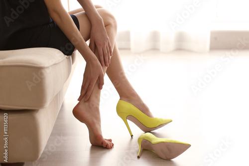 Obraz na plátně Woman in yellow high heels shoes.
