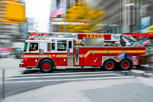 Canvas-taulu fire trucks and firefighters brigade in the city