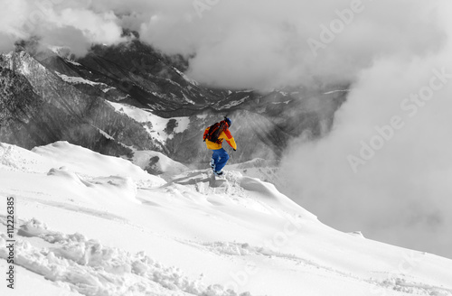 Canvas Print Snowboarder on off-piste slope an mountains in fog. Selective co