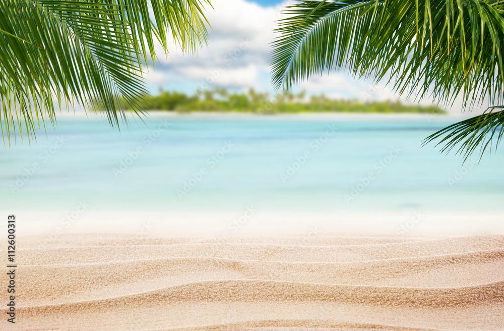 Sandy tropical beach with island on background