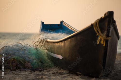 Canvas-taulu Fisherman boat with fishing nets on the Gokarna beach near the ocean in Karnatak
