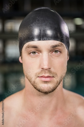 Canvas Print Portrait of swimmer standing by the pool