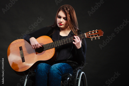 Tablou Canvas Disabled girl playing guitar.